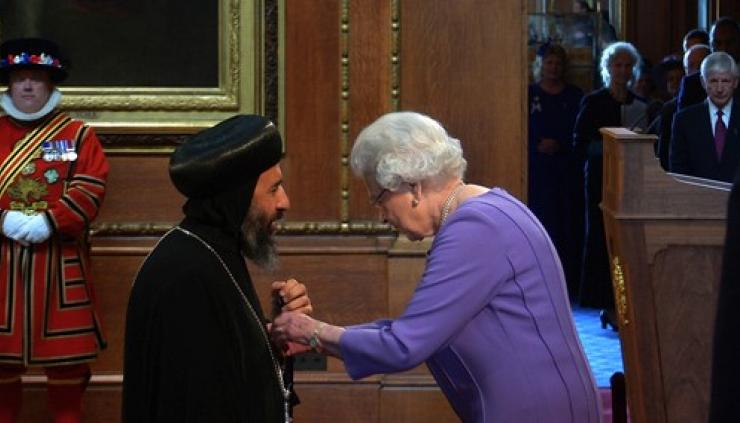 Bishop Angaelos receiving the OBE from Her Majesty the Queen